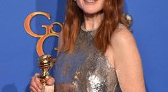 BEVERLY HILLS, CA - JANUARY 11: Actress Julianne Moore, winner of Best Actress in a Motion Picture - Drama for 'Still Alice,' leaves the press room during the 72nd Annual Golden Globe Awards at The Beverly Hilton Hotel on January 11, 2015 in Beverly Hills, California. (Photo by Kevin Winter/Getty Images)