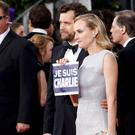 Actors Joshua Jackson and Diane Kruger hold a