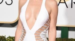 Actress Kate Hudson arrives on the red carpet for the 72nd annual Golden Globe Awards