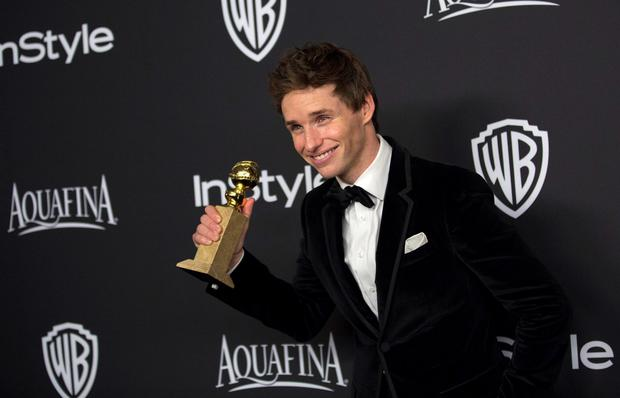 Actor Eddie Redmayne poses with his award for Best Performance by an Actor in a Motion Picture - Drama for