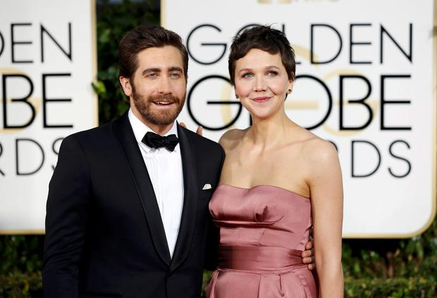 Actors Jake Gyllenhaal and Maggie Gyllenhaal arrive at the 72nd Golden Globe Awards. Reuters/Mario Anzuoni