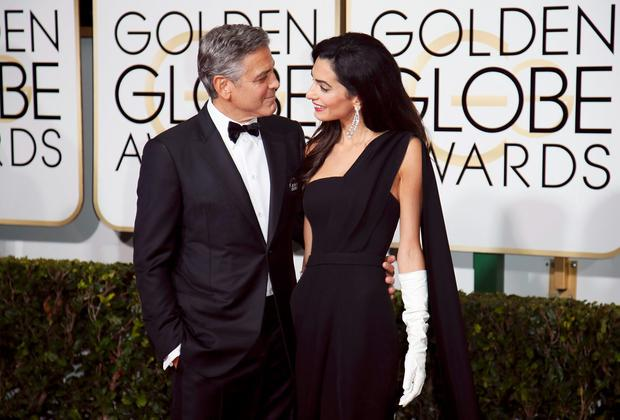 Actor George Clooney and wife, Amal Clooney, arrive at the Golden Globe Awards in Beverly Hills, California