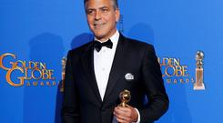 George Clooney at the Golden Globes with his Cecille B DeMille Lifetime Achievement Award - and a 'Je suis Charlie' button on his lapel