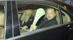 Breaking Bad actor Aaron Paul with a hurley he was given as a gift at the Merrion Hotel, Dublin.