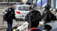 Members of the special French RAID forces secure the area for the visit by Israel's Prime Minister Benjamin Netanyahu to the Hyper Cacher kosher supermarket January 12, 2015 near the Porte de Vincennes in Paris. Photo: Reuters