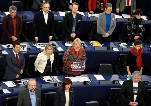 Members of the European Parliament observe a moment of silence at the European Parliament in Strasbourg, January 12, 2015, in tribute to the victims of the shootings by gunmen at the offices of the satirical weekly newspaper Charlie Hebdo, the killing of a police woman in Montrouge, and the hostage taking at a kosher supermarket at the Porte de Vincennes. REUTERS/Vincent Kessler