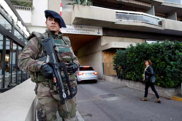 Soldier stands guard outside a synagogue in Marseille, southern France. France on Monday ordered 10,000 troops into the streets to protect sensitive sites after three days of bloodshed and terror, amid the hunt for accomplices to the attacks that left 17 people and the three gunmen dead (AP Photo/Claude Paris)