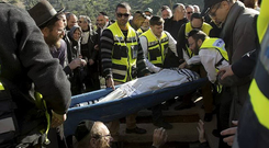 The body of Philippe Braham, one of four French Jews killed in an attack on a Paris kosher grocery, is lowered to the grave during their joint funeral in Jerusalem. Reuters/Ariel Schalit/Pool