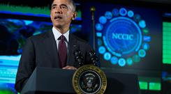 President Barack Obama speaks at the National Cybersecurity and Communications Integration Center on Tuesday. Obama renewed his call for Congress to pass cybersecurity legislation, including a proposal that encourages companies to share threat information with the government and protects them from potential lawsuits if they do (AP Photo/Evan Vucci)