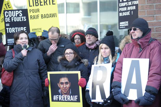 Ensaf Haidar(C), the wife of the Saudi Blogger Raef Badawi, holds a vigil in Montreal, Quebec urging Saudi Arabia to free her husband who was flogged in public January 9, 2015 near a mosque in the Red Sea city of Jeddah, receiving 50 lashes for