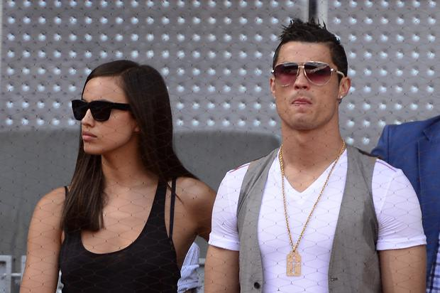 Real Madrid's Portuguese forward Cristiano Ronaldo (R) and his girlfriend Irina Shayk attend the tennis match Spanish player Rafael Nadal against Spanish player David Ferrer at the Madrid Masters at the Caja Magica (Magic Box) sports complex in Madrid on May 10, 2013. Nadal won 4-6, 7-6 (7/3), 6-0. AFP PHOTO/ JAVIER SORIANO (Photo credit should read JAVIER SORIANO/AFP/Getty Images)