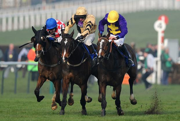 Davy Russell on Lord Windermere (R) win from David Casey on On His Own (centre) and Tom Scudamore on The Giant Bolster