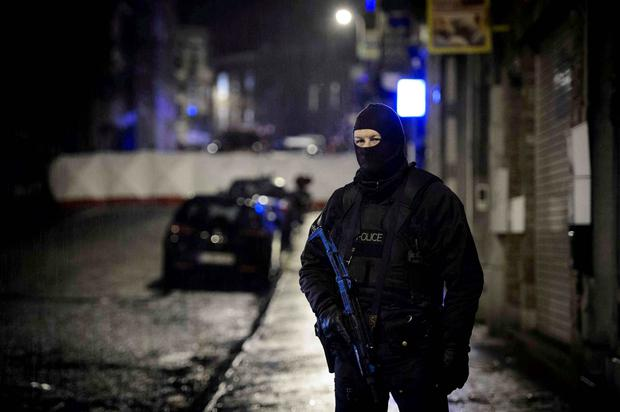 A Belgian special forces police blocks a street in central Verviers, a town between Liege and the German border, in the east of Belgium. Reuters