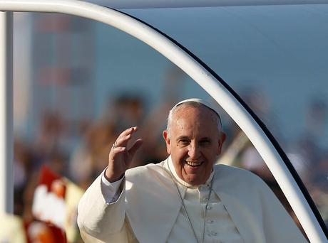 Pope Francis waves to Catholic faithful as he arrives to lead mass in Colombo, Sri Lanka. Reuters