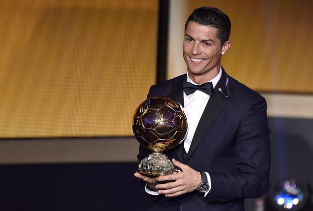 Cristiano Ronaldo reacts after collecting the Ballon D'Or for the third time in Zurich