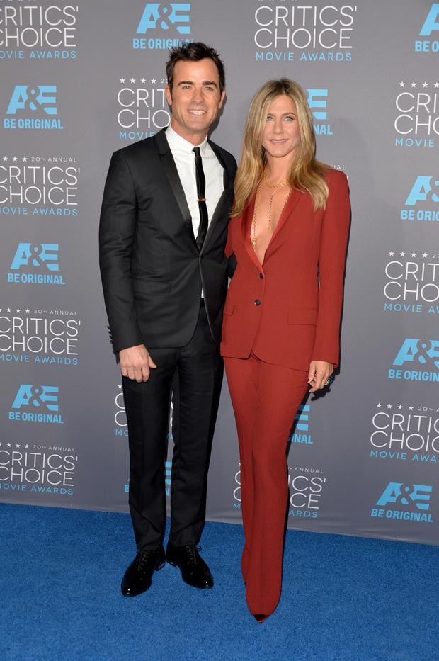 Actors Justin Theroux (L) and Jennifer Aniston attend the 20th annual Critics' Choice Movie Awards at the Hollywood Palladium