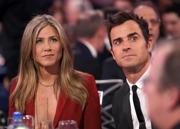 Actors Jennifer Aniston (L) and Justin Theroux during the 20th annual Critics' Choice Movie Awards at the Hollywood Palladium
