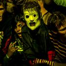 Masked fans of American heavy metal band Slipknot watch them perform on main stage during the Roskilde Festival on July 4, 2013. AFP PHOTO / SCANPIX DENMARK/ TORKIL ADSERSEN DENMARK OUT (Photo credit should read TORKIL ADSERSEN/AFP/Getty Images)