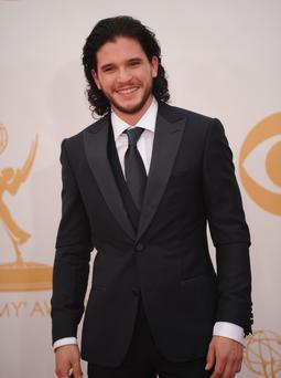 Actor Kit Harrington arrives on the red carpet for the 65th Emmy Awards in Los Angeles, California, on September 22, 2013. AFP PHOTO / Robyn Beck (Photo credit should read ROBYN BECK/AFP/Getty Images)