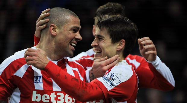 Stoke City's Bojan Krkic celebrates opening the scoring against Leicester City with Jonathan Walters and Marko Arnautovic