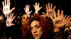 Anti-austerity protesters in Nicosia show their opposition to a proposed levy on bank deposits