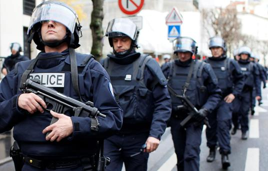 French intervention police take up position near the scene of a hostage taking in Paris last month, which left the country on a high terror alert
