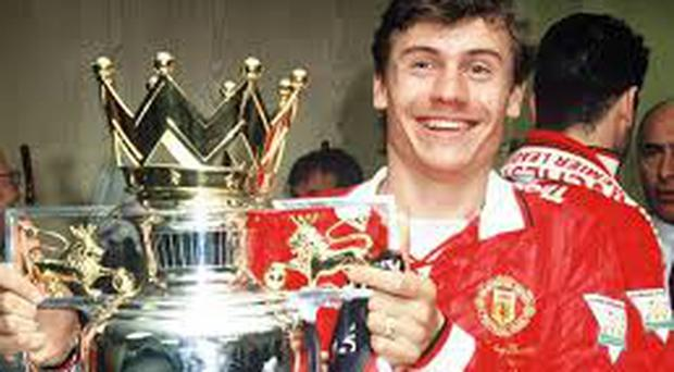 Andrei Kanchelskis celebrates a Premier League title success during his playing days at Manchester United.
