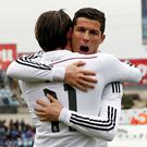 Real Madrid's Cristiano Ronaldo congratulates his teammate Gareth Bale after scoring a goal against Getafe