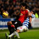 Manchester United striker Radamel Falcao battles for the ball with QPR's Mauricio Isla during their clash at Loftus Road. Photo: Mike Hewitt/Getty Images