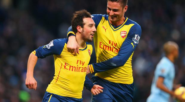 Santi Cazorla celebrates with Olivier Giroud after giving Arsenal the lead in their win over Manchester City at the Etihad. Photo: Alex Livesey/Getty Images