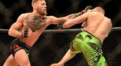 Conor McGregor, left, in action against Dennis Siver. UFC Fight Night, Conor McGregor v Dennis Siver, TD Garden, Boston, Massachusetts, USA. Picture credit: Ramsey Cardy / SPORTSFILE