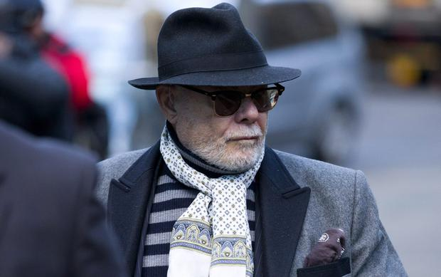 British former pop star Gary Glitter, whose real name is Paul Gadd, arrives at Southwark Crown Court in central London. The 1970s glam rocker faces a total of 10 charges related to alleged sex crimes committed between 1975 and 1980. Gadd pleaded not guilty at a pre-trial hearing on November 11, 2014.