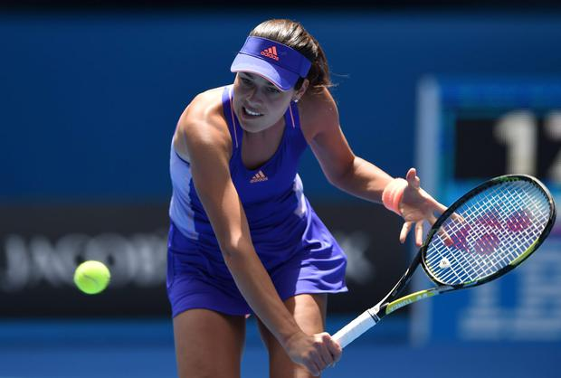 Serbia's Ana Ivanovic plays a shot during her women's singles match against Czech Republic's Lucie Hradecka