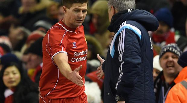 Steven Gerrard shakes hands with Chelsea manager Jose Mourinho