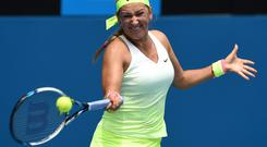 Belarus's Victoria Azarenka hits a return against Sloane Stephens of the US during their women's singles match