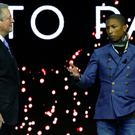 Nobel Peace Prize laureate Al Gore (L), former U.S. Vice-President and Chairman and Co-Founder of Generation Investment Management listens to singer Pharrell Williams, Creative Director and Brand Ambassador of Bionic Yarn at the What's Next? A Climate for Action event in the Swiss mountain resort of Davos January 21, 2015. More than 1,500 business leaders and 40 heads of state or government will attend the Jan. 21-24 meeting of the World Economic Forum (WEF) to network and discuss big themes, from the price of oil to the future of the Internet. This year they are meeting in the midst of upheaval, with security forces on heightened alert after attacks in Paris, the European Central Bank considering a radical government bond-buying programme and the safe-haven Swiss franc rocketing. REUTERS/Ruben Sprich (SWITZERLAND - Tags: ENTERTAINMENT BUSINESS POLITICS)