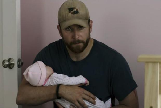 Bradley Cooper cuddles the obviously plastic baby in American Sniper