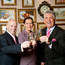 Hoteliers Marc Gysling and Deirdre McGlone celebrate Harvey's Point's Hotel of the Year Award from TripAdvisor.