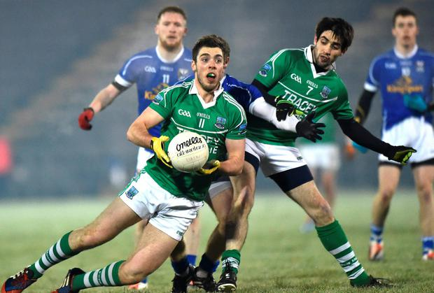 Ryan Jones, Fermanagh, with support from team-mate Marty O'Brien, in action against Jack Brady, Cavan
