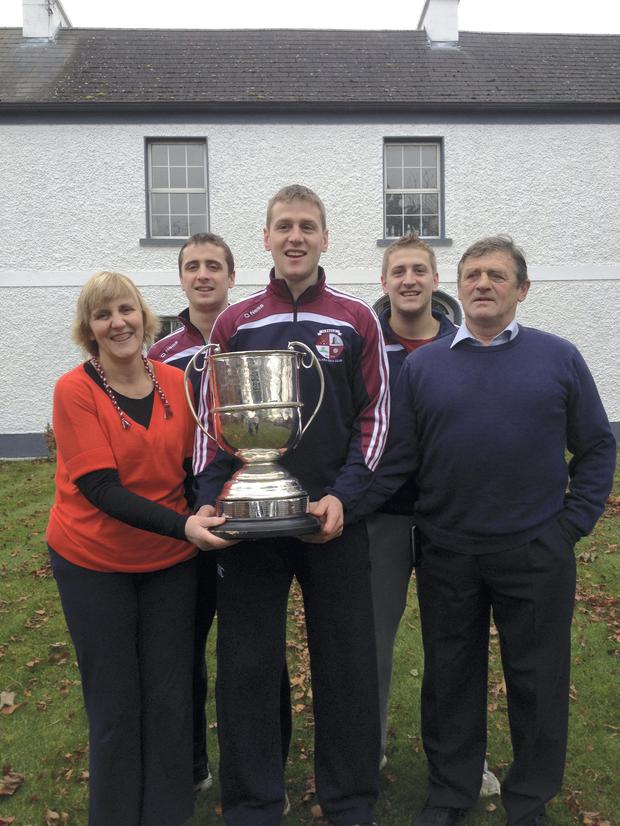 Johnny Ryan, far right, pictured in 2013 outside the family home with his wife Lily and three sons: Tom; Kilkenny All-Ireland hurling captain Lester, who is holding the Kilkenny Senior hurling championship cup; and Liam.
