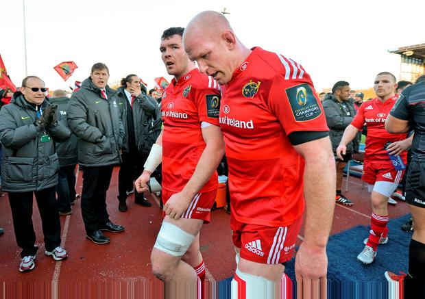 Peter O'Mahony, left, and Paul O'Connell lead Munster's vanquished troops off the pitch after losing to Saracens last weekend. The Red Army need to realise they no longer are the force they once were.