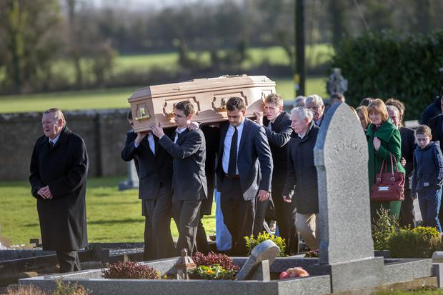 Kilkenny hurler Lester Ryan at the rear of the coffin at the funeral of his father John Ryan at the Church of St. Colmcille in Clara, Co. Kilkenny yesterday. Photo: Tony Gavin