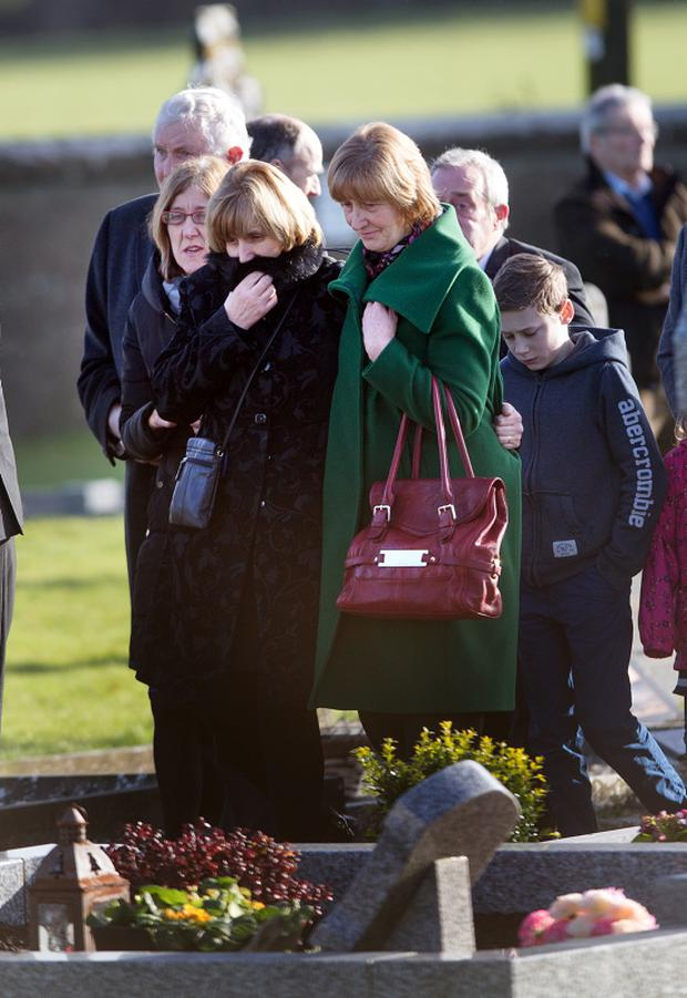 John Ryan's widow Lilly centre in black at the Church of St. Colmcille in Clara, Co. Kilkenny yesterday. Photo: Tony Gavin