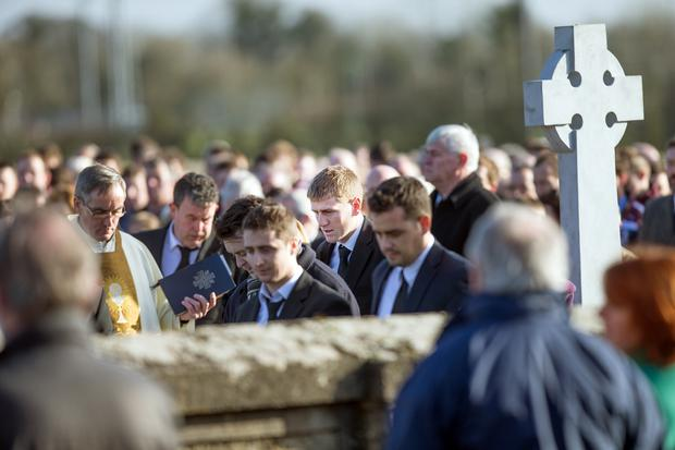 Kilkenny hurler Lester Ryan at the funeral of his father John Ryan at the Church of St. Colmcille in Clara, Co. Kilkenny yesterday. Photo: Tony Gavin