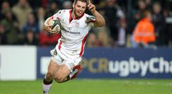 Ulster's Darren Cave celebrates as he runs in to score his side's second try. Photo: John Dickson