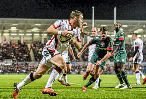 Darren Cave runs in to score Ulster's first try of the game