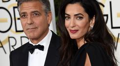 Actor George Clooney and Amal Clooney arrive on the red carpet for the 72nd annual Golden Globe Awards