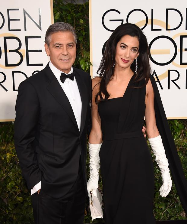 Actor George Clooney and Amal Clooney attend the 72nd Annual Golden Globe Awards
