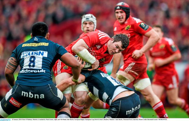 25 January 2015; Peter O'Mahony, Munster, is tackled by Mark Easter, right, and Vili Fihaki, Sale Sharks. European Rugby Champions Cup 2014/15, Pool 1, Round 6, Munster v Sale Sharks. Thomond Park, Limerick. Picture credit: Diarmuid Greene / SPORTSFILE