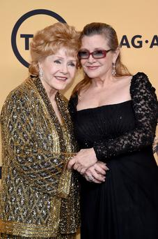Actresses Debbie Reynolds (L), recipient of the Screen Actors Guild Life Achievement Award, and Carrie Fisher pose in the press room at the 21st Annual Screen Actors Guild Awards at The Shrine Auditorium on January 25, 2015 in Los Angeles, Californi